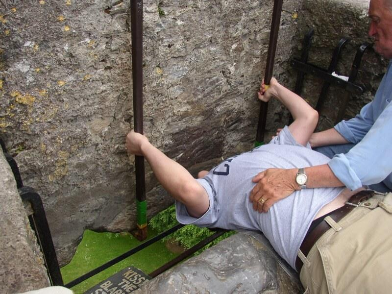 Kissing the stone in this unusual position is a large tourist attraction at the Blarney Castle.